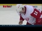 Daniel Alfredsson picks teeth up off ice